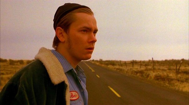 River Phoenix, waiting for a ride.
